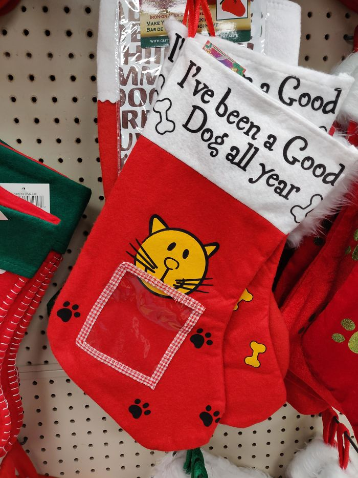 20. This Christmas Stocking For Your Dog That Has A Picture Of A Cat On It