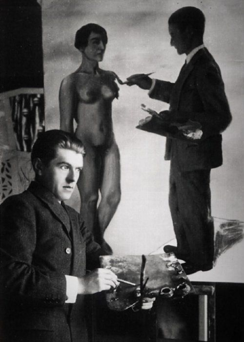 René-Magritte-in-front-of-his-work-Attempting-the-Impossible-1928